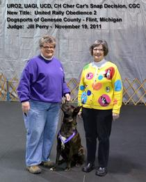 Dutch Shepherd CH Cher Car's Snap Decision earning her URO2 title in UKC Rally Obedience